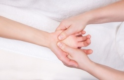 19892415 - qualified therapist doing therapeutic palm massage