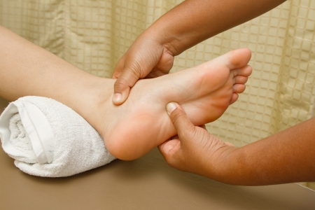 15400825 - reflexology foot massage, foot spa treatment